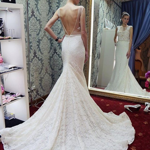 Sleeveless Lace Mermaid Wedding Dress Featuring Low V-Back and Long Train